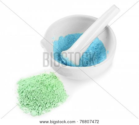 Laboratory pestle in mortar with ground material, isolated on white