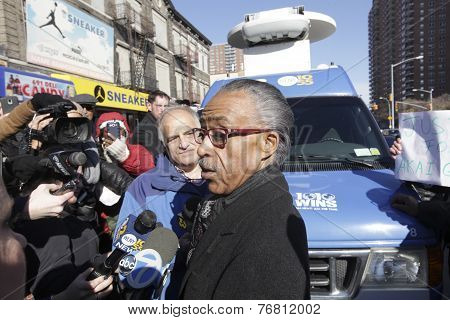 Rev Sharpton speaks to the press