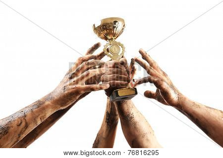 Gold cup in hands isolated on white
