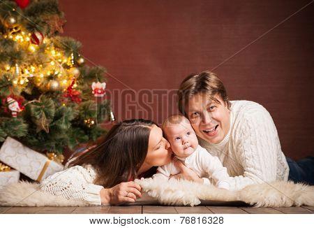 Happy family near Christmas tree at home