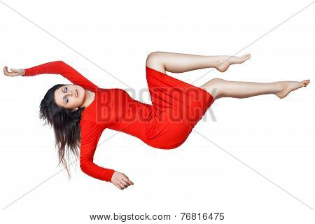 Levitates Woman In A Red Dress.