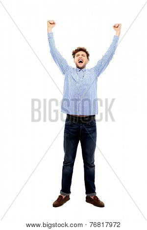 Successful man with arm up isolated on a white background