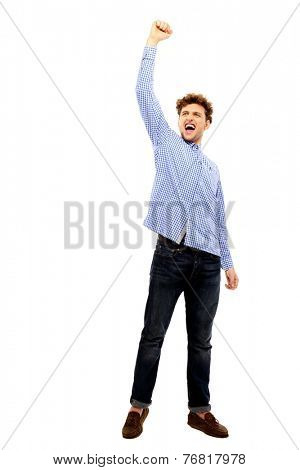 Full length portrait of a happy successful man with arm up