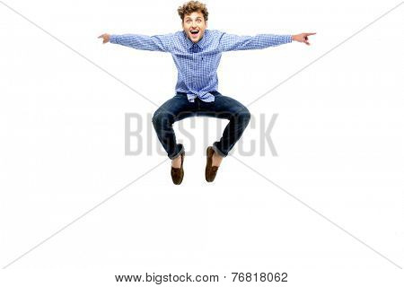 Funny man jumping over white background
