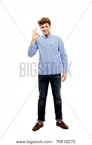 Full length portrait of a happy man gesture ok