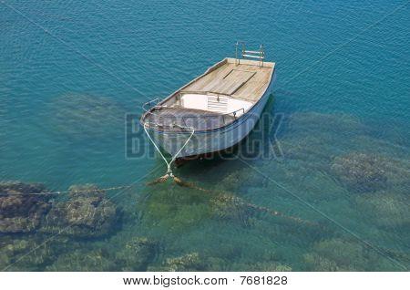 Alone boat in transparent sea.