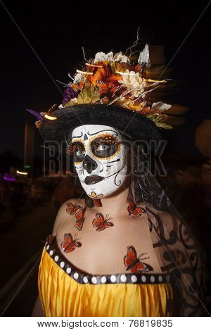 Woman In Dia De Los Muertos Makeup With Butterflies