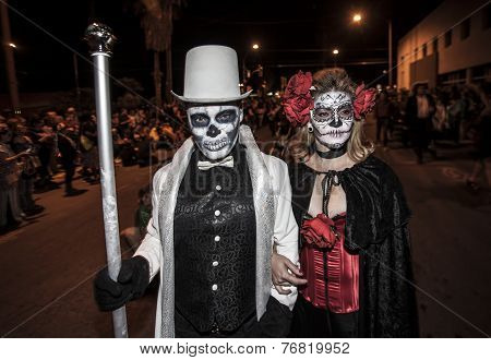 Couple In Dia De Los Muertos Procession
