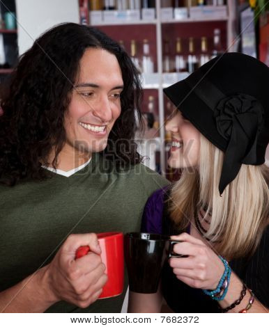 Interracial Couple Toasting With Coffee Cups