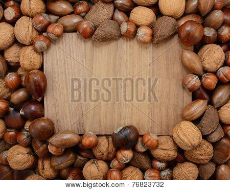 Mixed Nuts Frame A Wooden Background