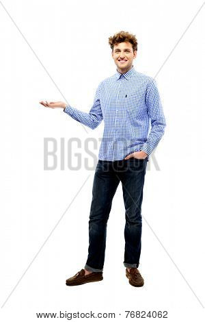 Full length portrait of a smiling man holding invisible product