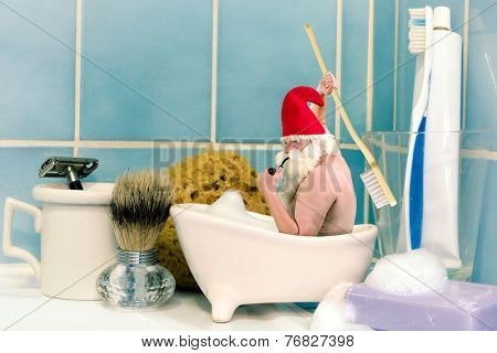 Funny old gnome taking a bath in a soap dish