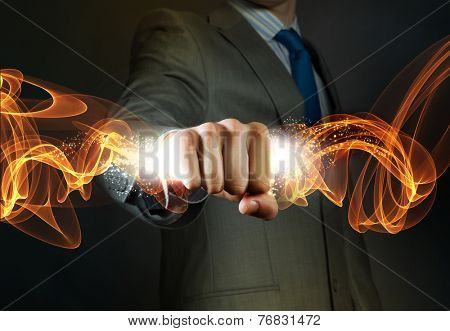 Close up of businessman grasping something in fist
