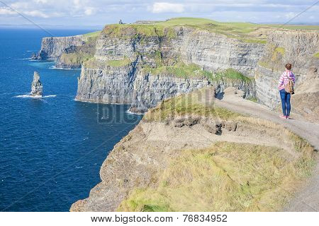 Girl At The Cliff Of Moher