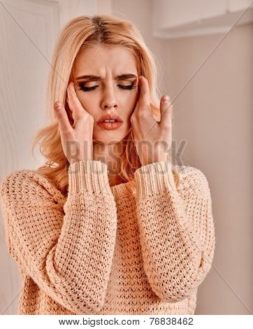 Young woman having  cold and high temperature.
