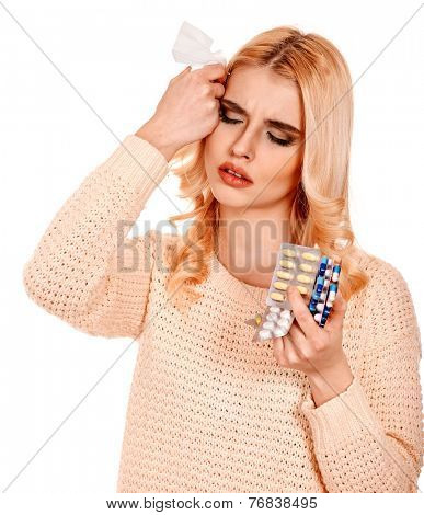 Young woman having headache  takes pills. Isolated.