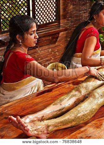 Young woman having feet Ayurveda spa massage.