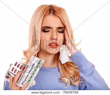 Young woman having flu takes pills. Isolated.