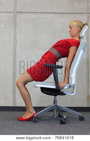 yoga on chair in office - business woman exercising