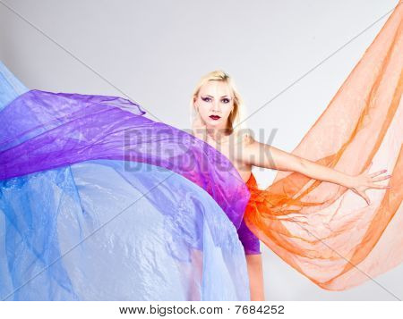 Beautiful Young Woman With Colorful Fabric