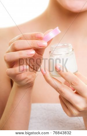 Skin Care. Girl Applying Moisturizing Cream.