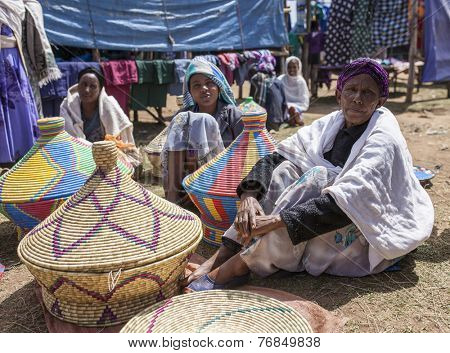 OROMIA, ETHIOPIA: NOVEMBER 5, 2014: Unidentified weavers sell traditional baskets in an outdoor market in Oromia, Ethiopia