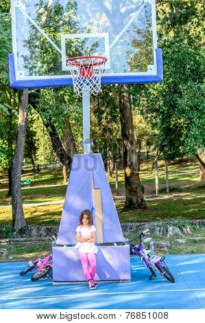 Seven year old  sad that no one wants to play basketball with her
