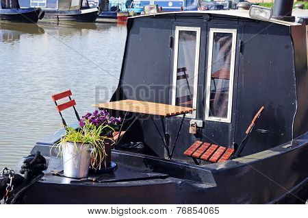 Table and chairs on narrowboat.