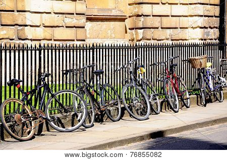 Bicycles leaning against railings.