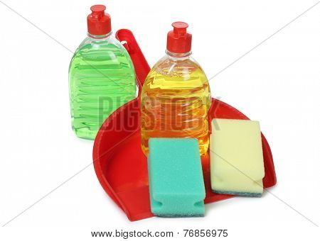 Sponge and cleaning products on white background