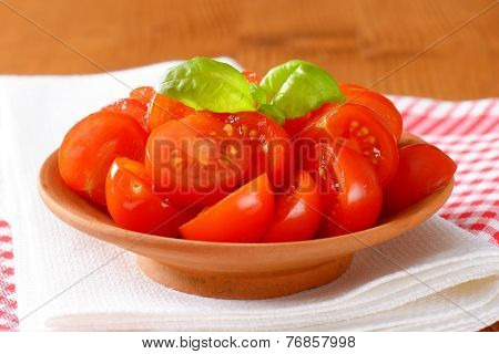freshly halved cherry tomatoes as a healthy snack