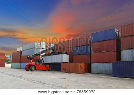 Forklift Handling The Container Box At Dockyard With Beautiful Sky