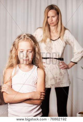Mom swears by daughter. Conflict, problems in family. Sad mother and child