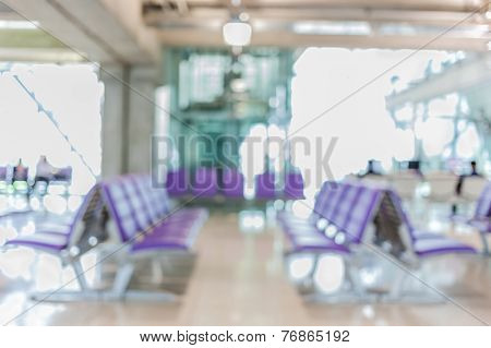 Blurred Background Of Seat Row Around Boarding Gate In Airport.