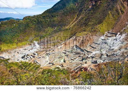 Owakudani valley, volcanic valley with active sulphur and hot springs, in Hakone, Kanagawa , Japan.