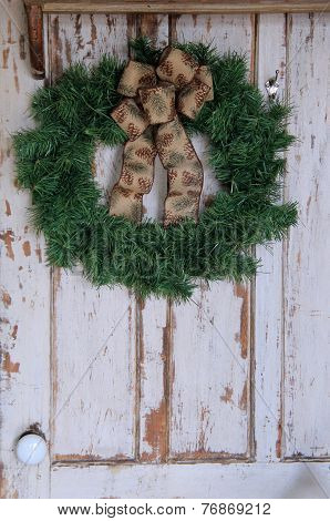 Holiday wreath on old,weathered door