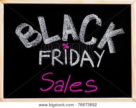 Black Friday Sales Advertisement Handwritten With Chalk On Wooden Frame Blackboard