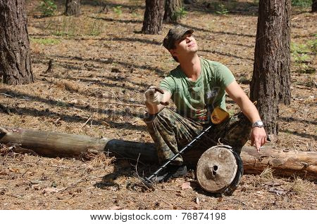 Kiev,Ukraine.June 3.Military archeology. Man with metal detector and German WWII anti tank landmine.At June 3,2012 in Kiev, Ukraine