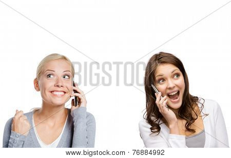 Smiley girls speaking on phone with fist up, isolated on white