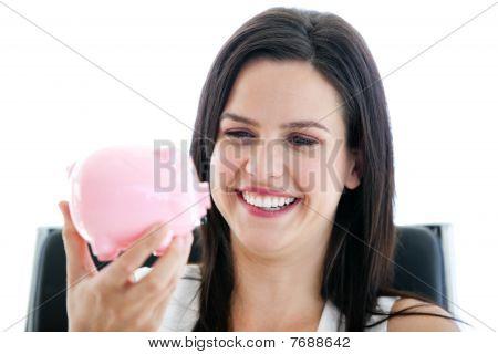Laughing Businesswoman Holding A Piggybank