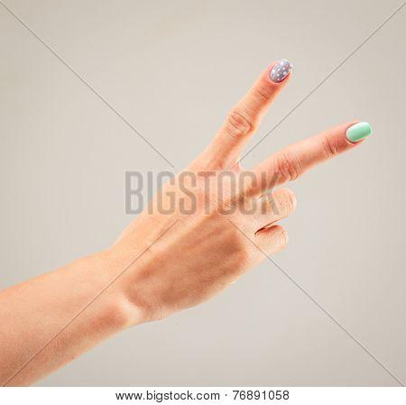 beautiful woman's hand, palm up. gray background