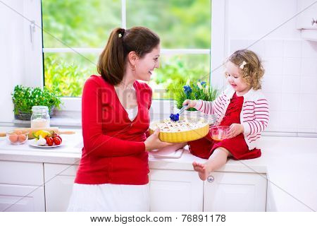 Young Mother And Daughter Baking A Pie