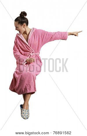 mad housewife sitting, screaming and pointing at something. isolated on white background