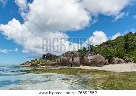 Stunning Natural View with Clear Lagoon Water, Huge Rocks and Green Trees on One Sunny Day, Located at Anse Source d'Argent in La Digue, Seychelles.