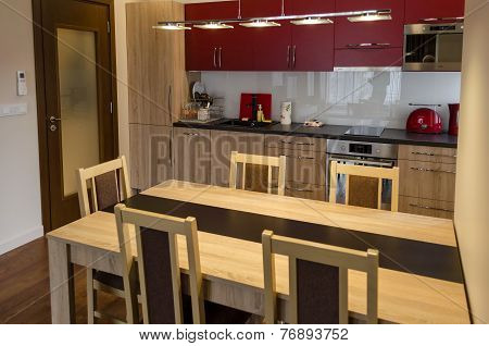 Living room with kitchen site and dining-table