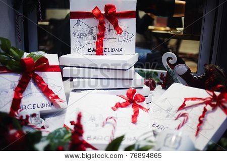 White gift boxes with red ribbon bow, happy new year composition