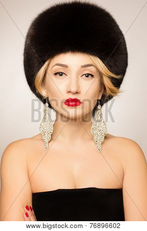 Jewelry and Beauty. Beautiful woman model wearing in fur hat. Fashion lady photo. Winter Girl. Fur F