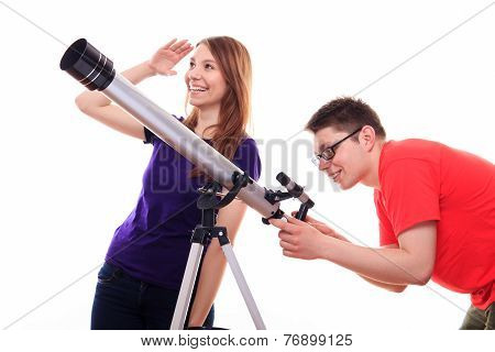 Man And Woman Watching The Stars Through A Telescope