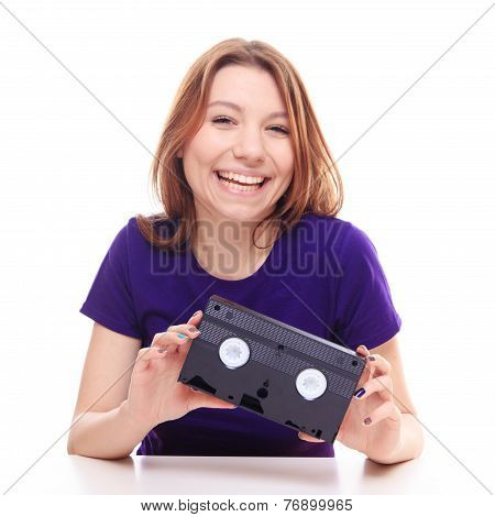 Young Girl Holding A Vhs Tape