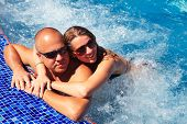 stock photo of hot-tub  - Loving happy couple in hot - JPG